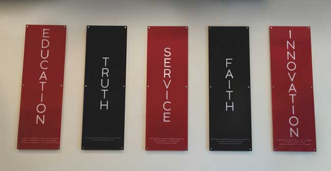 Signage of UIW Core Values: Education, Truth, Service, Faith and Innovation